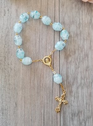 croix et chapelet bleu ciel